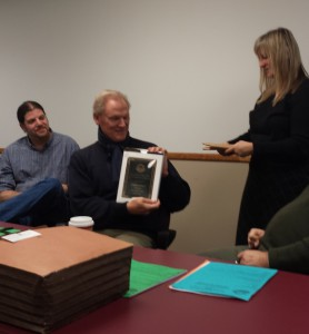 President Graydon Royce receives a plaque from his successor, Janet Moore, at the Dec. 9 Membership Meeting.