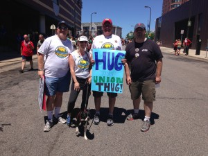 Twin Cities Guild members Mike Bucsko, Jessica Hayssen and her trusty Labor Pup, Oliver, Todd Dahlstrom and Chris Shields participated June 29 in the Ashley Rukes GLBT Pride Parade in Minneapolis.